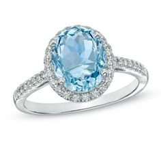 Honor her with the serene beauty of this elegant gemstone and diamond ring. Fashioned in cool 10K white gold, this ring features a 10.0 x 8.0mm oval-shaped icy-blue aquamarine center stone bordered with a halo frame of sparkling diamonds. Additional accent diamonds line the ring's shank, completing this exquisite style. Radiant with 1/5 ct. t.w. of diamonds and buffed to a bright shine, this is a look she'll enjoy every day of the week.