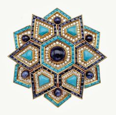 Brooch, 1969. Gold and platinum with turquoise, sapphires, and diamonds. Bulgari Heritage Collection ©️️️ Antonio Barrella Studio Orizzonte Roma