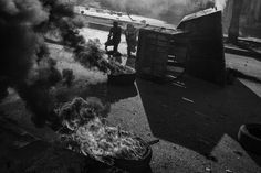 Youth burn tires during a demonstration in central Hebron, November 2015.