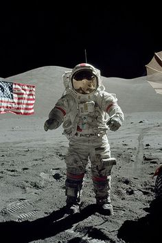 "Astronaut      How can the flag behind him be ""flying"" if there is no wind on the moon?"