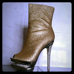 ❤SALE❤Gold sparkling  Peep toe Botties rhinestone Check out the very fierce and sparkling Peep toe Pump  Bootie! It features a padded insole,rhinestoneheels and pump,peep toe front,side rear zipper for closure,and sparkling glitter surface. This diva looking bottie is perfect for going out ...very comfortable ..Brand new never been worn Color:Gold ... Size 7 but able to fit 7.5 also ! Shoes Heeled Boots