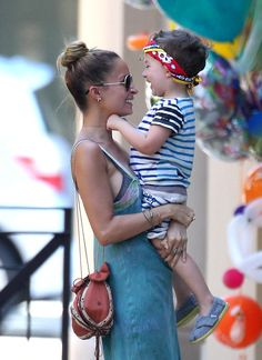 Nicole Richie smiles with her little man Sparrow