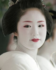 The maiko (apprentice geisha) Kimihiro taking part in the Hanagasa Junko procession, part of the month long Gion Festival. July 24, 2014, Kyoto, Japan.