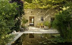 not usually a fan of square ponds but the limestone wall and the enclosed private feel make it beautiful