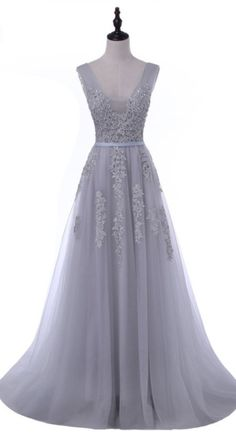 The grey sleeveless ball gown was dressed in a formal evening gown
