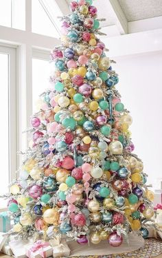 White Christmas tree with pastel ornaments. Expecting a baby near Christmas time? This tree would make a beautiful focal point for your shower decor and a pretty tree for baby's arrival. Kids love this fun and colourful tree! Gold Christmas Decorations, Christmas Tree Themes, Noel Christmas, Pink Christmas, Christmas Candy, All Things Christmas, Christmas Crafts, Christmas Lights, Christmas 2019