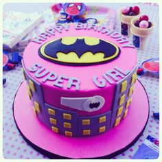 Batgirl Supergirl cake                                                                                                                                                                                  More