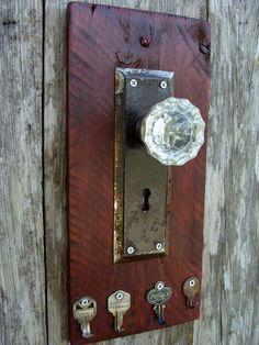 Decorative Rustic Key Rack using a glass door knob, antique door plate and repurposed keys