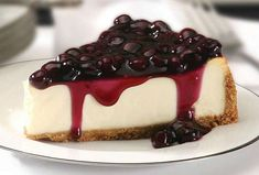 """""""This is a dense cheesecake that is very smooth and melts in your mouth. The white chocolate brandy sauce tops it off. I just nap it over the center of the slice of cheesecake on Cheesecake Day, No Bake Blueberry Cheesecake, Cheesecake Recipes, Dessert Recipes, Classic Cheesecake, Protein Cheesecake, Blueberry Cake, Blueberry Cream Cheese Pie, Blueberry Topping"""