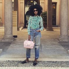 31 Perfect Looks To Copy This October #refinery29  http://www.refinery29.com/october-outfit-of-the-day-ideas#slide-22  How to make tons of trending pieces look good together.Miu Miu top, Levi's jeans, Gucci shoes, Versace bag....
