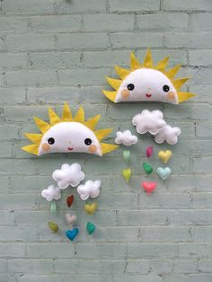 Sunshine Girl and Sundance Boy Baby Mobile - This handcrafted mobile is made from colorful wool felt and consists of three clouds, seven hearts and