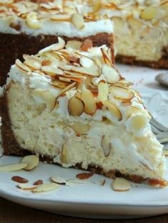 This Creamy White Chocolate & Almond Amaretto Cheesecake is a delicious dessert that's perfect for a special occasion or just because! Amaretto Cheesecake, Cheesecake Recipes, Dessert Recipes, White Chocolate Cheesecake, Chocolate Pasta, White Chocolate Recipes, Lime Cheesecake, Cheesecake Cupcakes, Chocolate Lovers
