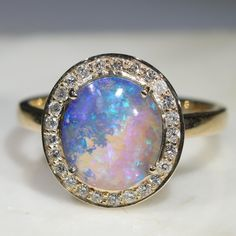 The Opal Anniversary Ring is a stunning natural Solid Boulder Opal The Opal has mystical blue and purple hues with twinkles of mint green. Gold Diamond Rings, Opal Rings, Gold Rings, Gemstone Rings, Purple Hues, Australian Opal, Patterns In Nature, Opal Jewelry, Anniversary Rings