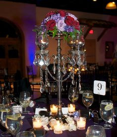 Candelabra Centerpieces. Love this. I would of course need way more flowers. and my fairytale theme doesn't really match fall colors