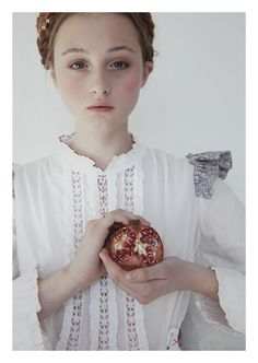 girl with pomegranate by saskia wagenvoort mixed and stitched artwork