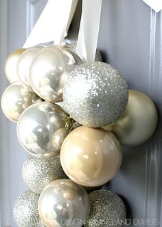 DIY Ornament Door Decoration using Dollar Store Ornaments! Only takes 30 minutes! via @Taryn H {Design, Dining + Diapers}