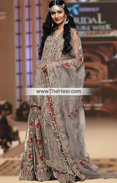 BW6995 Grullo Pale Silver Crinkle Chiffon Raw Silk Gharara Ethnic and luxurious, this bridal gharara dress is as gorgeous as a traditional outfit can get.. .   Top: Grullo Crinkle Chiffon Shirt features awesome and astonishing embellishments accentuates the neckline, armhole, front, chalks and side panels. Different patterns motifs are made all over. Sleeveless. V-neckline. Concealed zip closure back. Lining inside. Edges finished.   Bottom: Pale Silver Raw Silk Comes with flared gharara is…