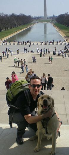 A young veteran and his service dog.