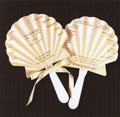 Absolutely love these sea shell wedding program fans.
