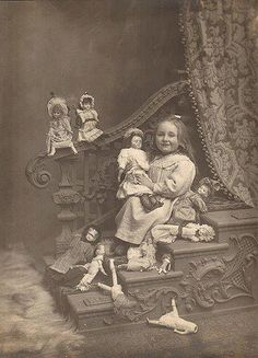 Creepy victorian child with her dolls
