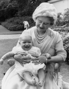 Prince Andrew sits on his grandmother's lap in this photo from 1960.**