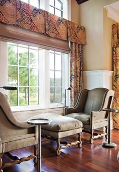 A nest doesn't always have to be a cramped space.    You can also use furniture to create spaces that might seem too tight design-wise, but these spaces feel just right for cuddling up with a friend over coffee. The proximity of the furniture to the three walls, as well as to the other person, creates security. Meanwhile vistas exist out the window, into the room and up to the ceiling.