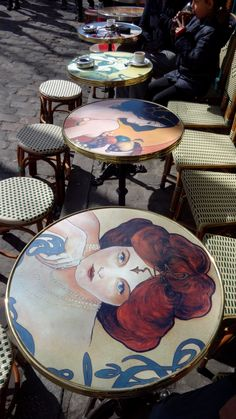 Montmartre, Paris, sidewalk cafe tables with art nouveau paintings of women on them Montmartre Paris, Paris Cafe, Paris Paris, Art Nouveau, French Cafe, I Love Paris, Wanderlust, Oui Oui, Cafe Bar