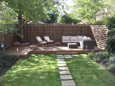 Outdoor , Grabbing Exterior Beauty with Small Backyard Deck Ideas : Cozy Sofa For Seating At Low Deck In Small Backyard