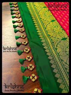 Krishne's tassel collection includes traditional kuchu, crochet patterns, contemporary and bridal saree tassels.Price ranges between and Wedding Dress Price Ranges Saree Tassels Designs, Saree Kuchu Designs, Wedding Saree Blouse Designs, Wedding Silk Saree, Silk Saree Blouse Designs, Lace Saree, Saree Dress, Wedding Dress Costume, Diy Wedding Dress