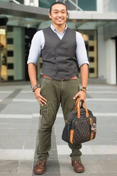 Orchard Road, SINGAPORE. Azahari Amri, freelance designer. Uniqlo shirt, tailored vest (from Singapore), Dockers pants and belt, footwear from Red Wing Shoes, Seiko watch, bracelet from a street stall in Australia. Photo Louis Kwok