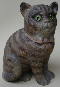 """This listing is for a wonderful antique (late 19th. century) terracotta tobacco jar (humidor) in the form of a cat (kitten). This wonderful model has glass inset eyes and was made by Bernhard Bloch from Eichwald in Bohemia. This piece measures 8-1/2"""" high (21,5 cm). There are a few chips and there is some wear from age and use, but really these flaws do not detract from the appearance of this delightful figural tobacco jar!"""