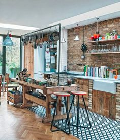 Love the tiles, reclaimed wood look, hanging pans etc