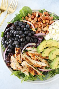 Chicken Blueberry Feta Salad with avocado, almonds, red onion, and a simple lemon poppy seed dressing makes a great summer meal. Everyone loves this fresh, simple, and healthy salad.