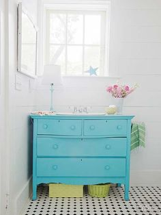 Repurposing is an inexpensive way to update your home. This old bedroom dresser was painted blue for modern cottage style. The furniture piece offers extra storage and easy customization. Keep the existing surface or add a stone countertop, and install a simple sink bowl.
