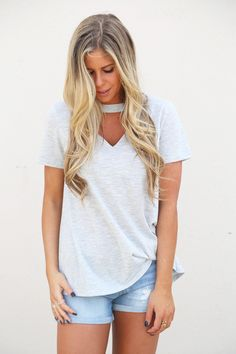 Heather Gray in color. V-neck tee shirt with choker and slight open back detail. Button closure in the back. Model in this photo is a and is wearing a small. Small M Chocker Shirt, Polyvore Outfits, V Neck Tee, Fashion Forward, Heather Grey, Hug, Style Inspiration, T Shirts For Women, My Style