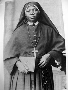 """Mary protected me even before I knew her!""    St. Josephine Bakhita is in the center of the group photo   Picture source   ""Bakhita has lef..."