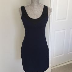 Express body con dress with mesh detail Body con dress with mesh detail at straps/neckline from Express. 65% rayon 30% nylon 5% spandex. Side zip closure.    Measurements: Bust: 30 in.  Waist:28 in.  Hips:36 in.  Length:33 in. Express Dresses