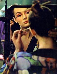 Jean Shrimpton applying cosmetics