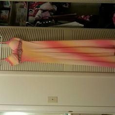 Evening/prom full length dress One of a kind, bought in a  kentucky coture shop. Light colors of pink, orange, yellow in an ombre fashion. Worn once. Great condition. No stains or damages. Dresses