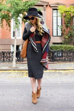 Atlantic-Pacific's Blair Eadie wears a sweater dress with a belt, scarf, ankle boots, and hat  - click to see how other bloggers and street style stars are wearing them