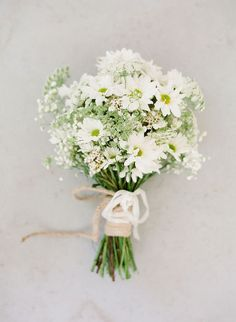 While flowers are a lovely part of any wedding day, they certainly can add up quickly. Between the centerpieces, ceremony florals, boutonnieres, corsages, and bride and bridesmaid bouquets, it's easy
