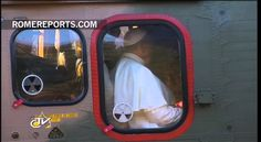 Pope shows his love, by outlining a heart by  helicopter's window