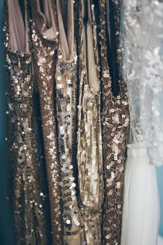 Gold glittering bridesmaid dresses, brides dress from Sarah Seven. Photo: Christy Cassano-Meyer