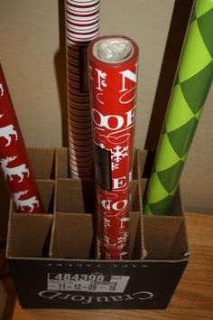 Wrapping paper cheap storage idea! I would cover the box with wrapping paper for a decorative touch.