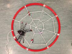 Spiders web around a hoop. Minibeast activities.
