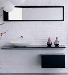 Love this sleek, barely-there modern bathroom look.