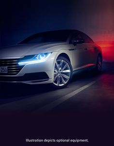 This photograph focusses on design details like the wheels of the Volkswagen Arteon Elegance and the distinct front of the car.