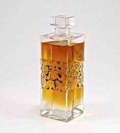 1924 R. Lalique, Forvil 5 Fleurs perfume bottle and stopper, clear glass, black patina highlighting recessed detail. Lalique mark. 4 in.