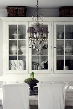 ~ love the gray-purple shades and dark baskets in this mostly white dining room