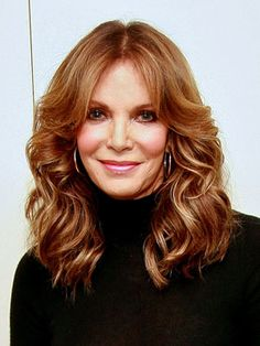 Jaclyn Smith looks gorgeous with her long layers of hair. I'm not sure of her exact age (some sources say that she is 66), but she is definitely over 60 and looks great with her long hair.
